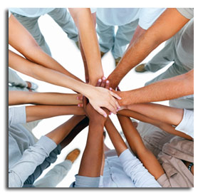 many hands grasping each other working together