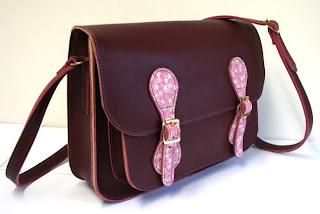 plum school satchel with blossom fobs