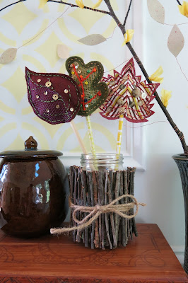 http://purl3agony.hubpages.com/hub/DIY-Craft-Tutorial-Scrap-Fabric-Fall-Autumn-Leaves-Table-Decoration-and-Napkin-Ring