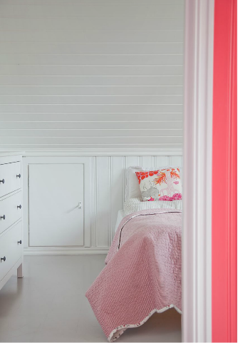 attic guest bedroom bright and colorful_coral