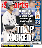 By losing, Yanks win back page