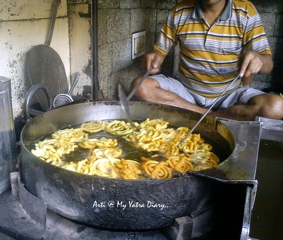 Hot piping Jalebis being fried at Old famous Jalebiwala - Chandni Chawk street food, Delhi