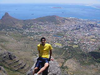 Ryan with Lion's Head, Signal Hill, and Table Bay in the background.