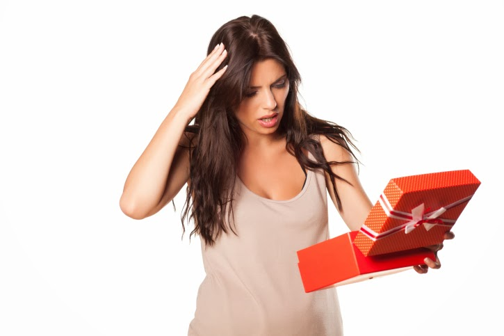 Woman not impressed with package contents