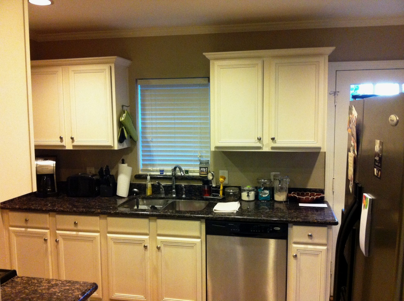 Kitchen part one. I love the cottage cabinets and black granite