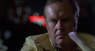 M. Emmet Walsh as the Private Detective Loren Visser, Blood Simple, Directed by Joel Coen, Coen Brothers debut film