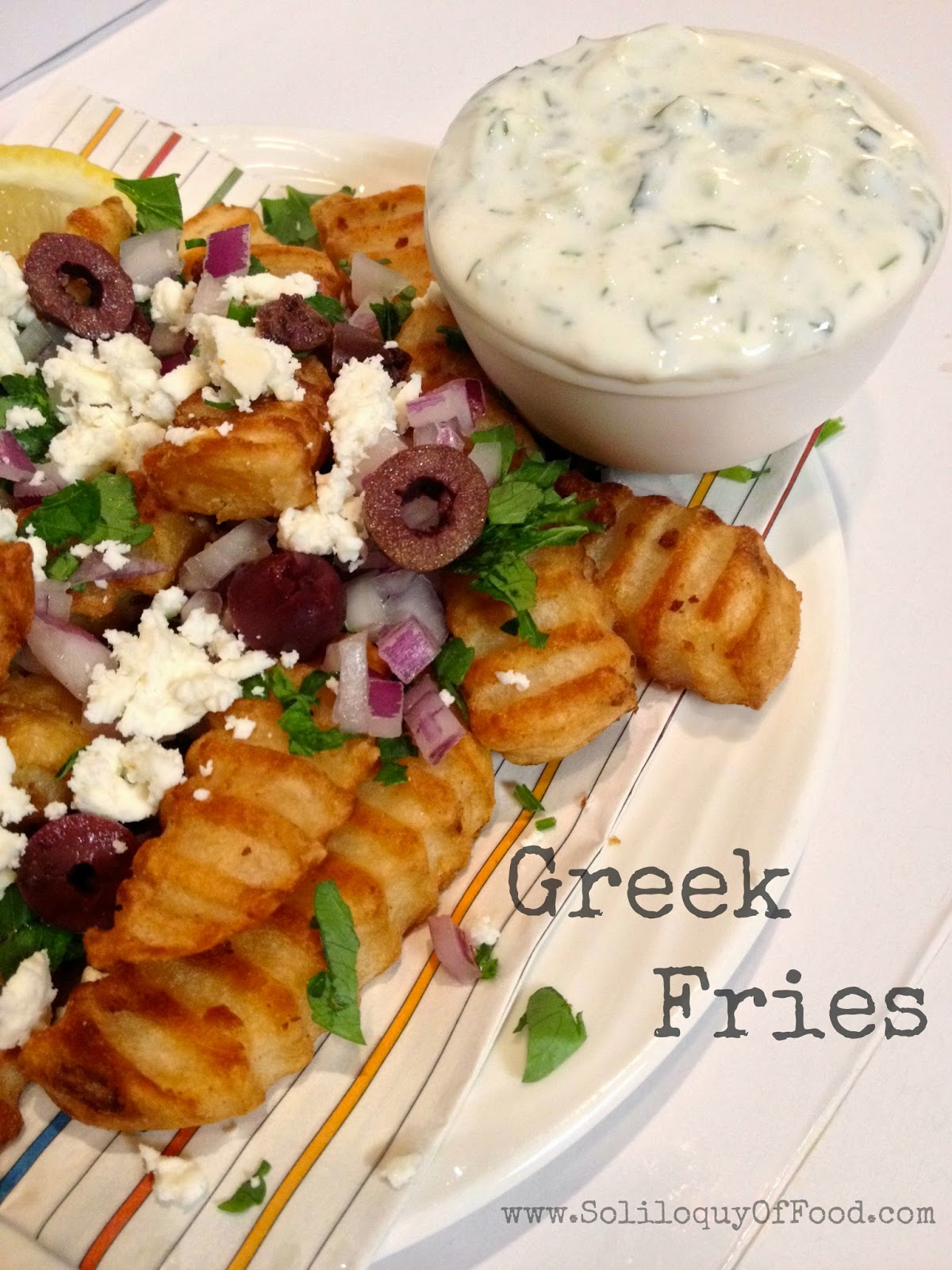 Greek Fries ~ seasoned with salt and lemon, topped with parsley, onions, olives and feta ~  www.SoliloquyOfFood.com via LoveBakesGoodCakes.com