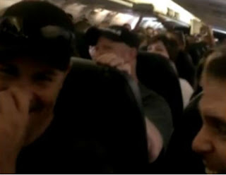 Delayed passengers make the best of a bad situation with a sing-a-long