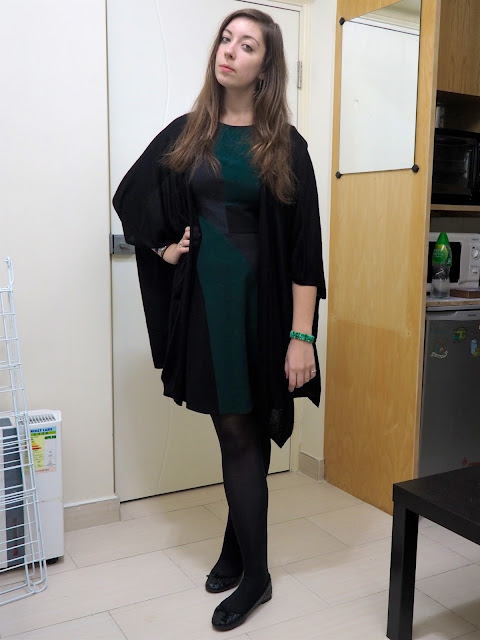 Emerald & Jade | outfit of green, black and grey geometric design smart dress, with black open sleeve draped cardigan, tights & flat shoes