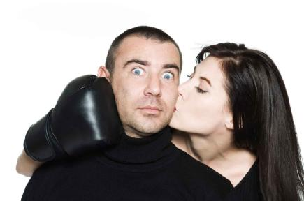 Men's Top 5 Dating Fears - man afraid of commitment - woman kiss a frightened man