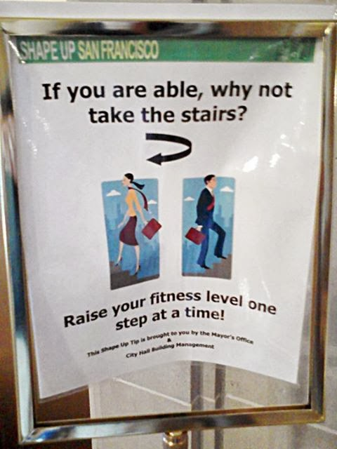"Promotional sign by Shape Up San Francisco depicting cartoon man and woman walking up flights of stairs holding briefcases. Caption reads, ""If you are able, why not take the stairs? Raise your fitness level one step at a time? This Shape Up Tip is brought to you by the Mayor's Office & City Hall Building Management."""