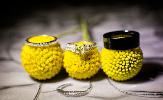 Wedding rings on yellow flowers - Kent Buttars, Seattle Wedding Officiant