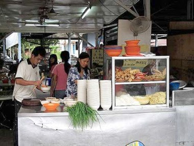 Noodles galore: There's a row of stalls selling curry laksa and soupy noodles along Jalan Loke Yew in Tanjung Malim.