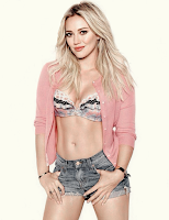 Hilary Duff wearing a bra and short shorts