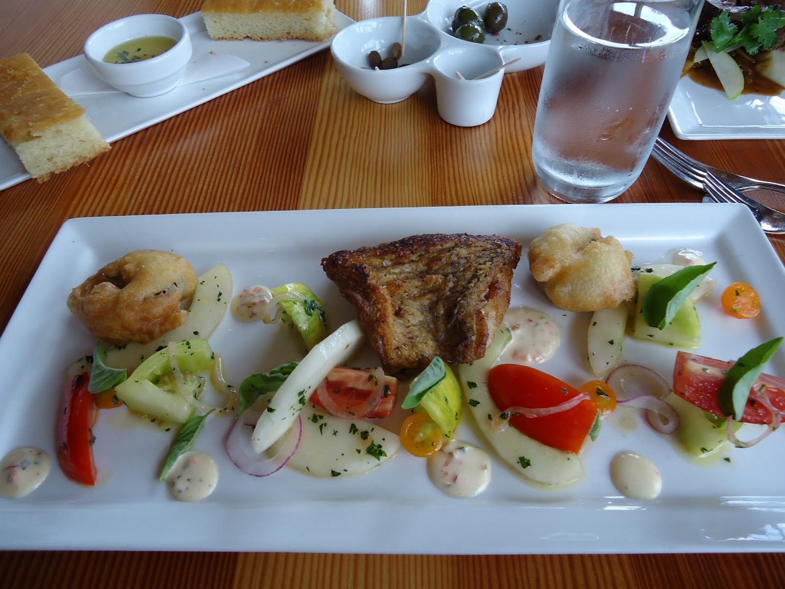 Tile fish, cucumber-tomato salad, tempura eggplant, garden pepper ...