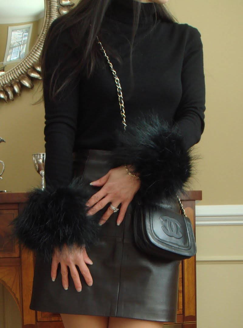 Close up of the fur cuffs and crossbody bag.