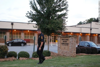 Photo of a police officer on a school campus.