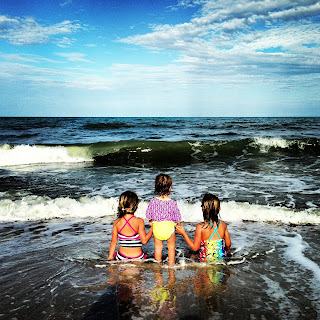 My family playing in the waves in Florida