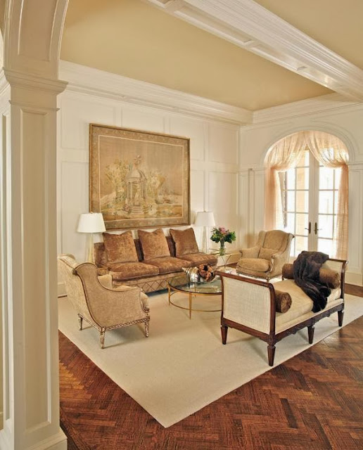 elegant lounge area in creamy neutral tone with various seating options