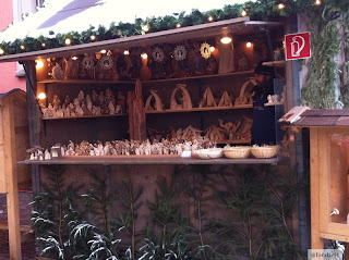 wood carving sales stand on the christmas market