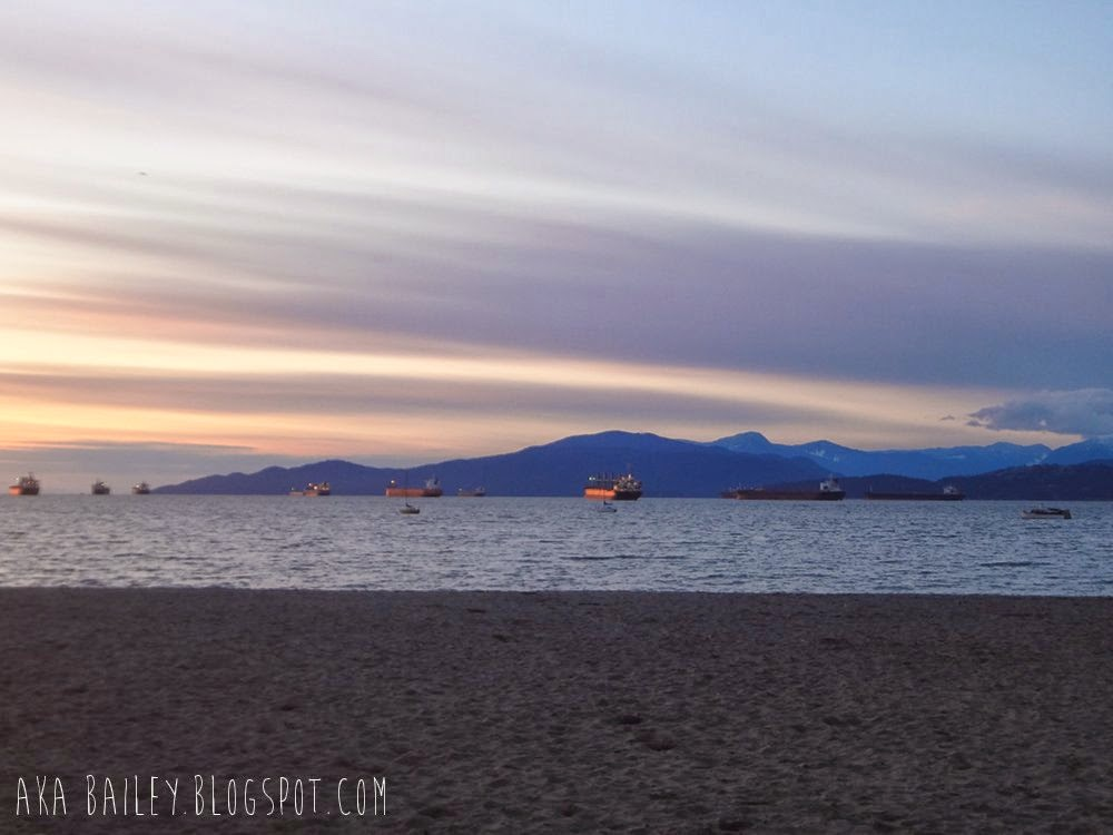Sunset in English Bay in Vancouver, ships and mountains