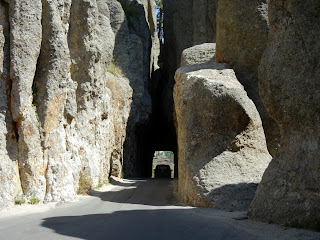 Narrow tunnels while driving on the Needles Highway in Custer State Park in South Dakota