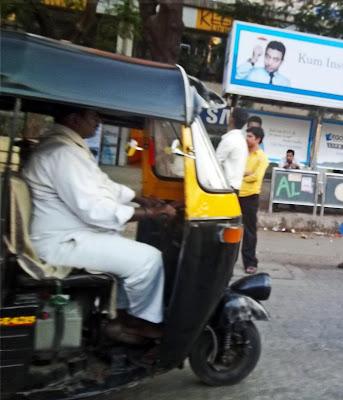 overweight rickshaw driver