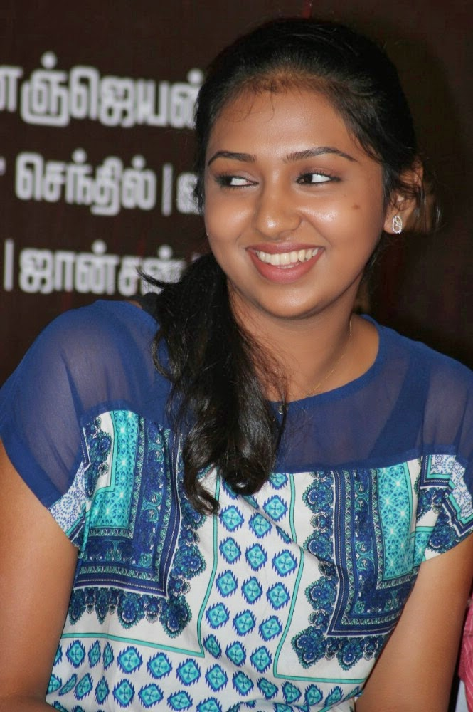 Lakshmi Menon Photos at Blue Dress at Naan Sigappu ... Naan Sigappu Manithan Lakshmi Menon Hot Stills