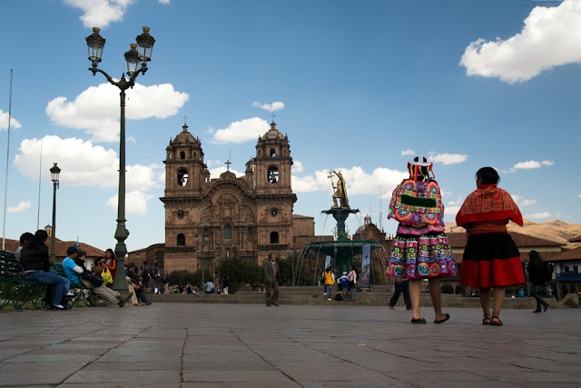 A photograph of some locals at the Plaza taken in Cusco, Peru