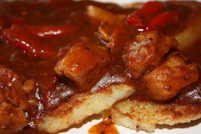 Delicious Polish Pork Goulash over potato pancakes!