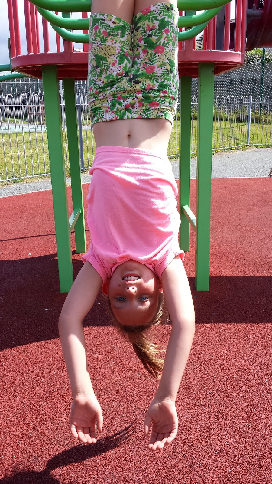 Rebecca hangs upside down park