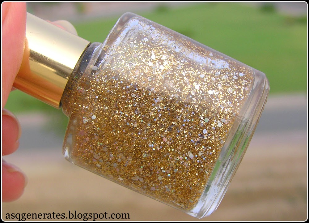 How To:Pedicure gold glitter nail polish