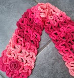 http://www.ravelry.com/patterns/library/snake-stitch-neck-warmer-or-scarf