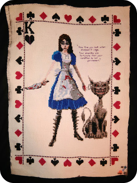 "An A4 cross-stitch of Alice and the Cheshire cat from the game ""Alice: Madness Returns"""