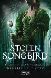 cover art for Stolen Songbird, featuring a pale girl holding a glowing rose. Her face isn't visible. She stands in a cave