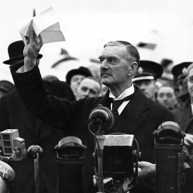"British prime minister Neville Chamberlain displaying the Anglo-German Declaration to the crowd at the Heston Aerodrome on September 30, 1938. Later that day, in front of 10 Downing Street, he would declare ""I believe it is peace for our time."" Within a year Britain would be engulfed in World War II."