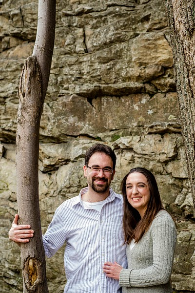 portrait of a couple in front of a rock wall