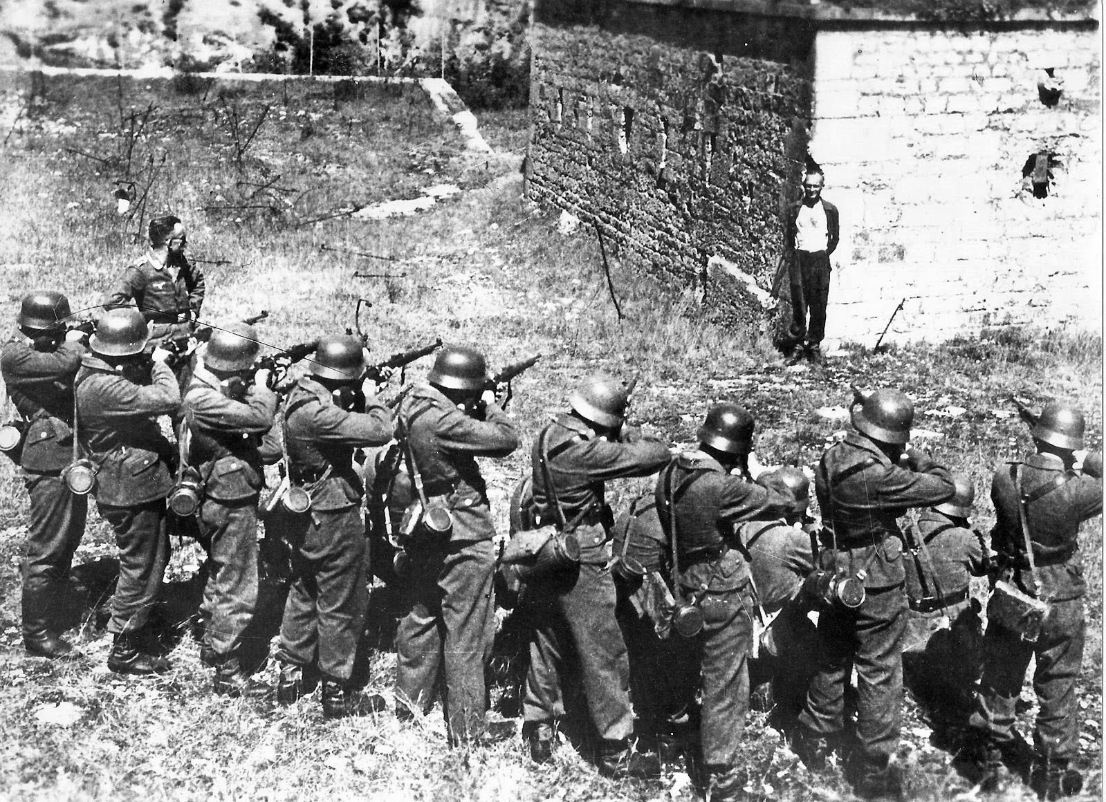 Georges Blind, a member of the French resistance, smiling at a German firing squad, October 1944