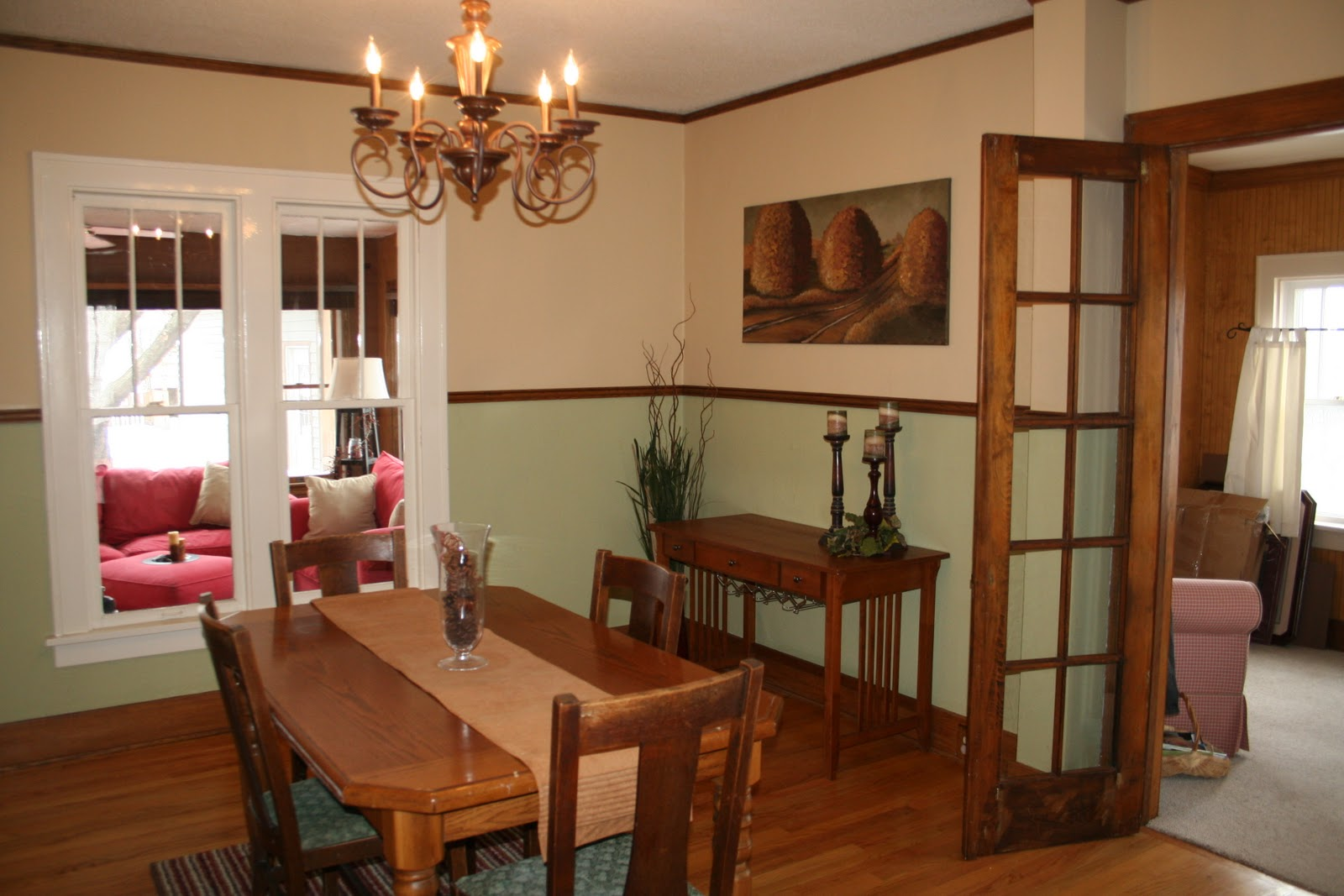 The Dining Room Is Situated In The Center Of The House With Chandelier  Lighting And Original Oak Hardwood Floors And Chair Rail.