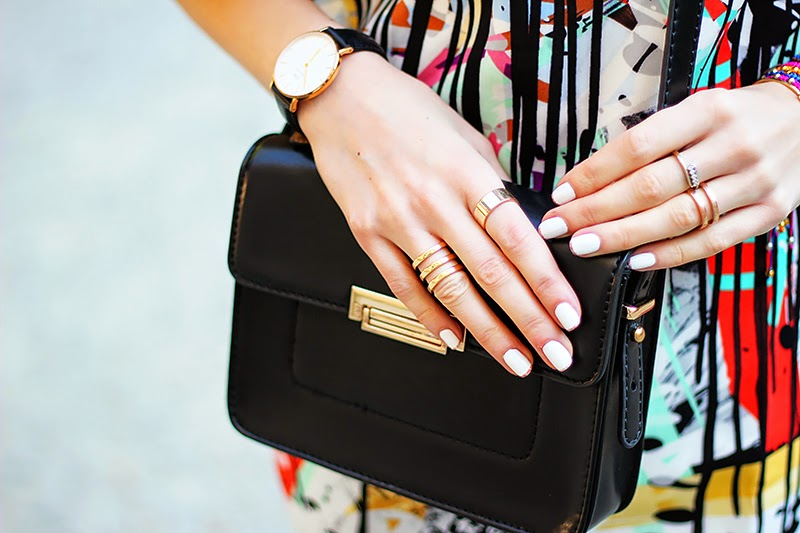 graffiti print dress, Daniel Wellington watch, rings, Mango mini bag