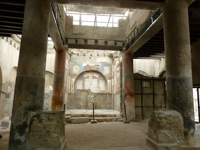 inside two level Ercolano school for freed slaves with fresco back wall