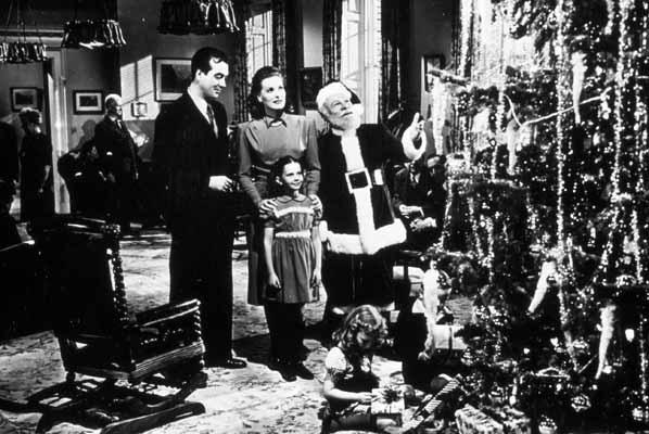 Kris, Susan, Doris and Fred look at a Christmas tree in Miracle on 34th Street