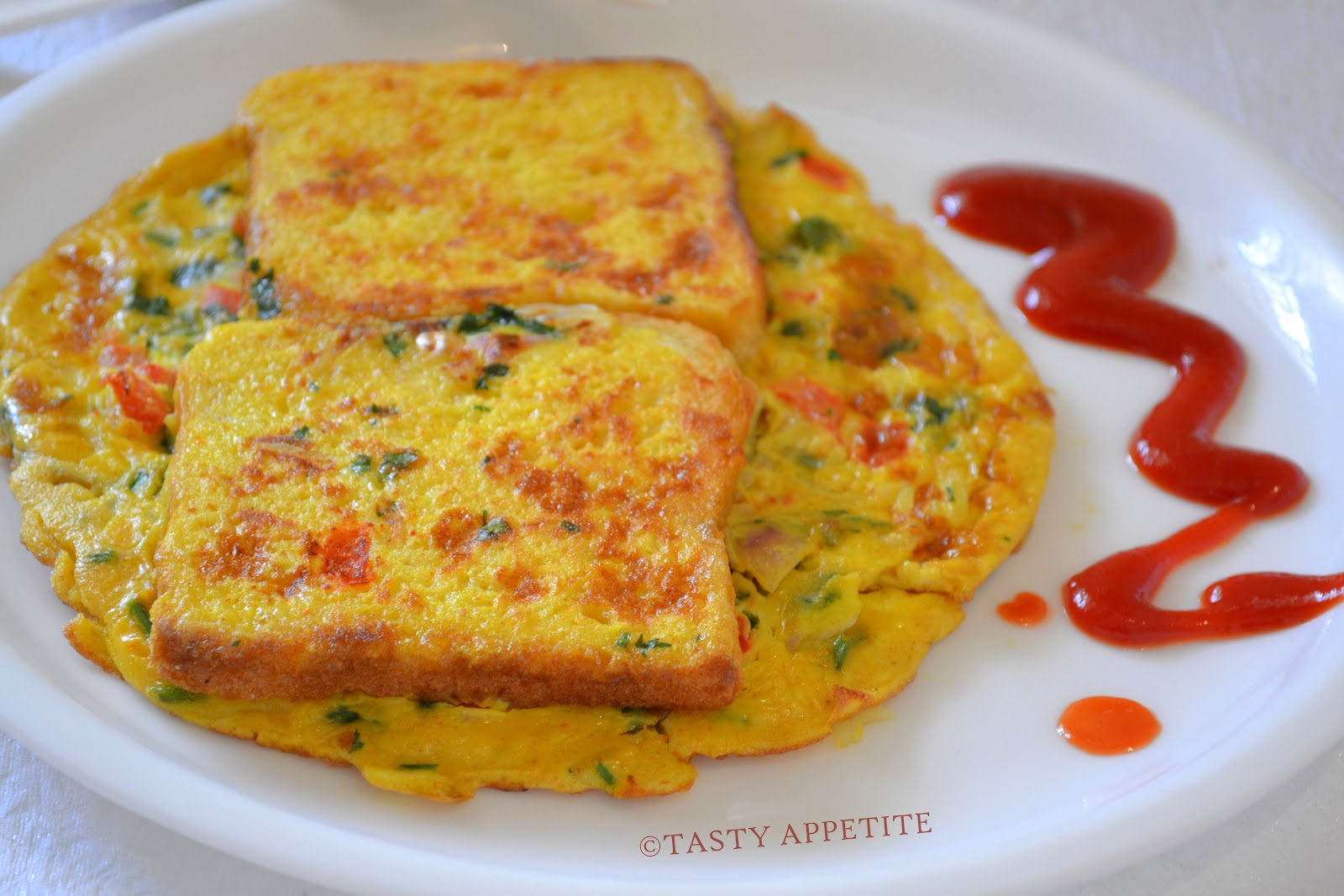 ... make delicious & healthy Bread Omelette using this simple recipe