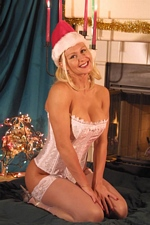 Trixie Swallows waits for Santa to give him a blowjob he'll never forget!