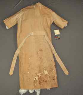Edison's lab coat, conservation treatment and rehousing of the coat for storage done by Spicer Art Conservation