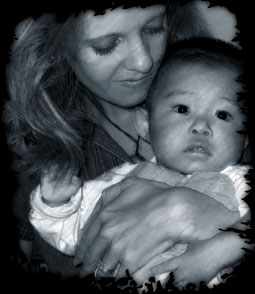 Kay Bratt holding orphan from Chinese orphanage