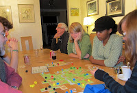 Carcassonne - The players watch as Sinead considers where to place her next tile