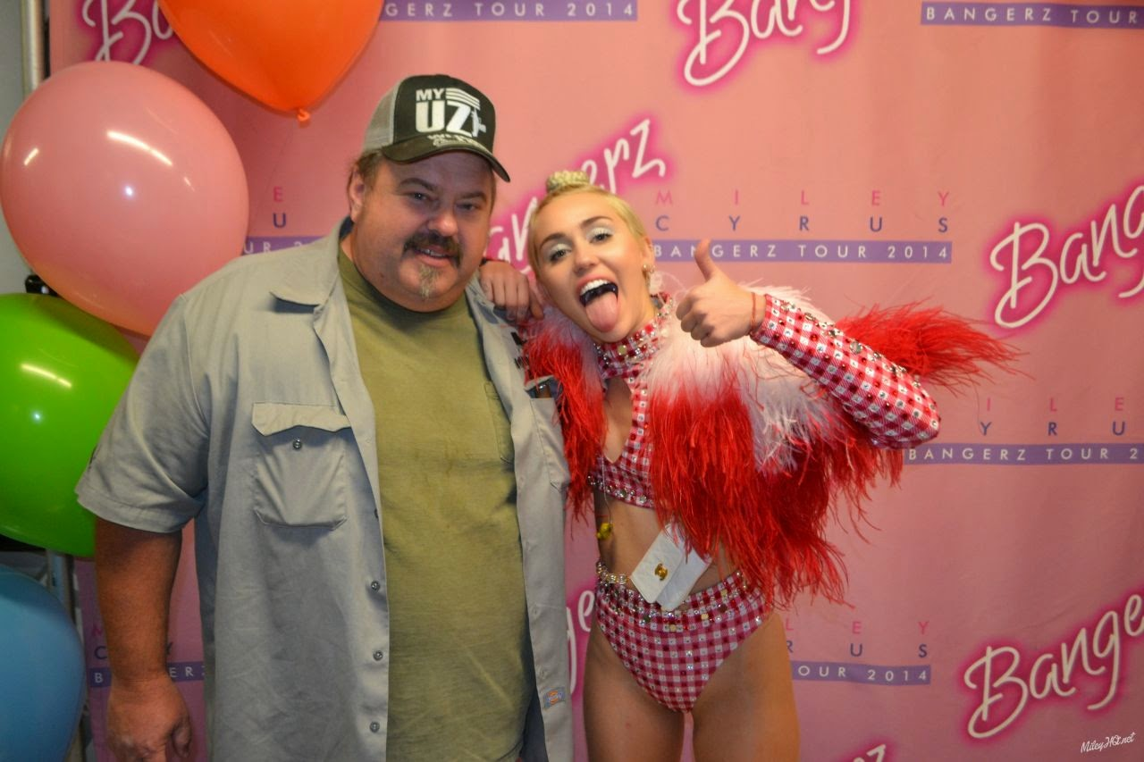Miley Cyrus poses with fans at 'Meet & Greet' held at United Centre Chicago