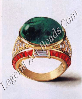 Two rings of yellow gold. The one on the left is set with brilliant and baguette-cut diamonds, baguette-cut rubies and a large oval cabochon emerald.