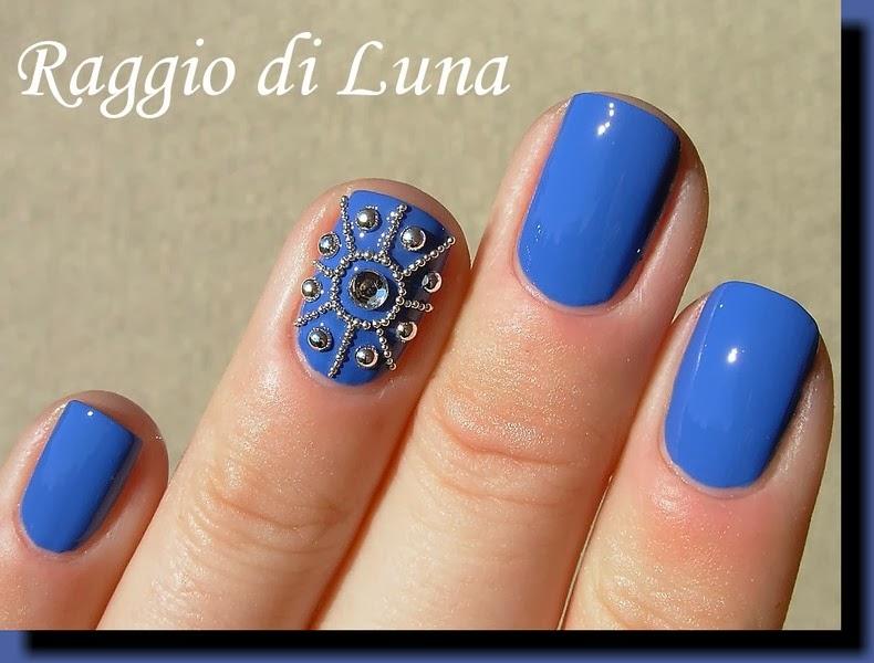 Raggio di Luna Nails: Silver nail art studs and beads on blue